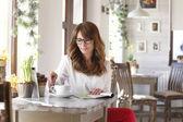 Beautiful mature woman in coffee shop — Stock Photo