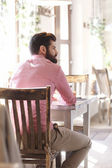 Young man sitting in coffee shop. — Stock Photo