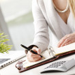Businesswoman makes a note in notebook. — Stock Photo #41396613