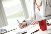 Businesswoman fill the form — Stock Photo