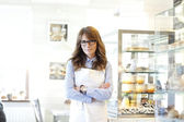 Portrait of bakery shop owner — Stock Photo