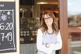 Beautiful coffee shop owner — Stockfoto