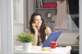 Business owner using her smartphone — Stock Photo