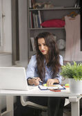 Young businesswoman working at home — Stock Photo