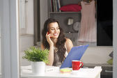 Beautiful businesswoman working at home — Stock Photo