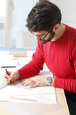 Young architect working in studio. — Stock Photo