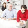Business team in architect studio — Stock Photo #42851851