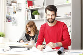 Young architect working in studio — Stock Photo