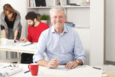 Senior architect working in studio — Stock Photo