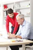 Young and senior businessmen working — Stock Photo