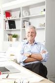 Senior businessman working in studio — Stock Photo