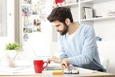 Businessman working at home. — Stock Photo