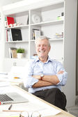 Senior businessman working in studio — Stock Photo