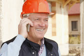 Construction architect using his mobile — Stock Photo