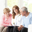 Elderly couple consulting with doctor — Stock Photo #44059471