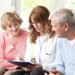Elderly couple consulting with doctor — Stock Photo #44059473