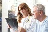 Female doctor analyzing x-ray — Foto de Stock