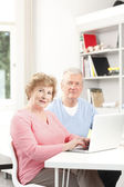 Senior couple surfing on internet — Stock Photo