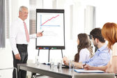 Senior businessman presenting ideas — Stock Photo