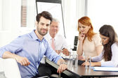 Businessman smiling at meeting — Stock Photo