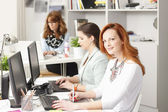 Teamwork at modern graphics studio — Stock Photo