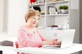 Senior woman surfing on internet. — Stock Photo