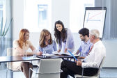Business people discussing at meeting — Stockfoto