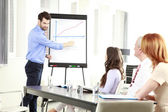 Young businessman presenting ideas — Stock Photo