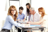Beautiful businesswoman at meeting — Stock Photo