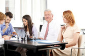 Business people discussing at meeting — Stock Photo