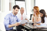 Business people at meeting and working on laptop — Stock Photo