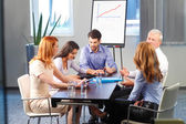 Man presenting his ideas to colleagues — Stock Photo