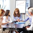 Business people at meeting and working on laptop — Stock Photo #48730131
