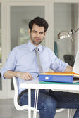 Businessman sitting at office and working — Stock Photo