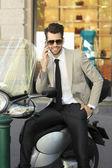 Modern businessman using his mobile — Stock Photo