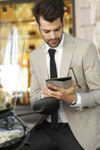 Modern businessman using tablet — Stockfoto