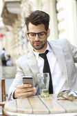 Businessman sitting in coffee shop — Stock Photo