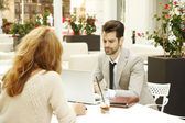 Businessman and businesswoman working together — Stock Photo