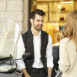 Businessman with scooter discussing with woman — Stock Photo #49921627