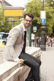 Modern businessman at the city — Stock Photo