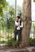 Urban businessman in park — Stock Photo