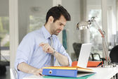 Businessman at office working on laptop — Stock Photo