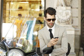 Businessman using his phone — Stock Photo