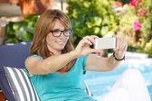 Woman at garden taking self portrait — Stock Photo