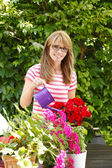 Flower shop owner standing at desk — Stock Photo