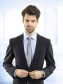 Confident young modern businessman — Stock Photo