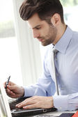 Modern young businessman at office — Stock Photo