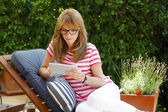 Business woman sitting at garden — Stock Photo