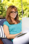 Woman working at home in garden — Stock Photo