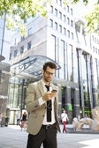 Broker with mobile walking — Stock Photo
